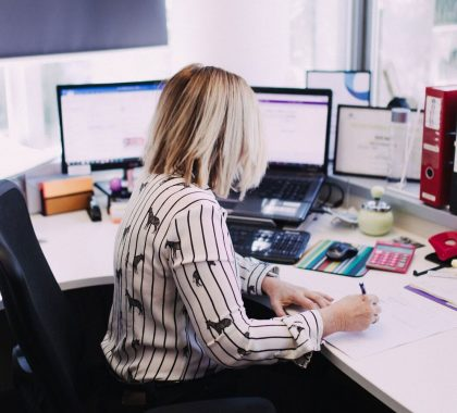 Woman Doing Bookkeeping in an Office Setting